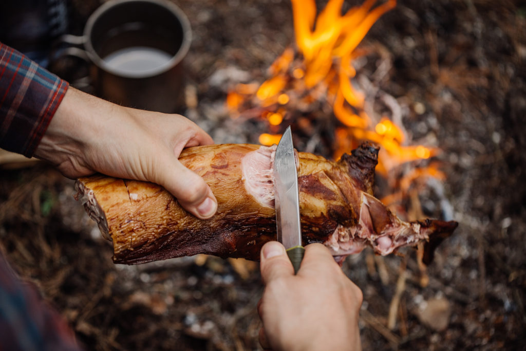 Man carving grilled