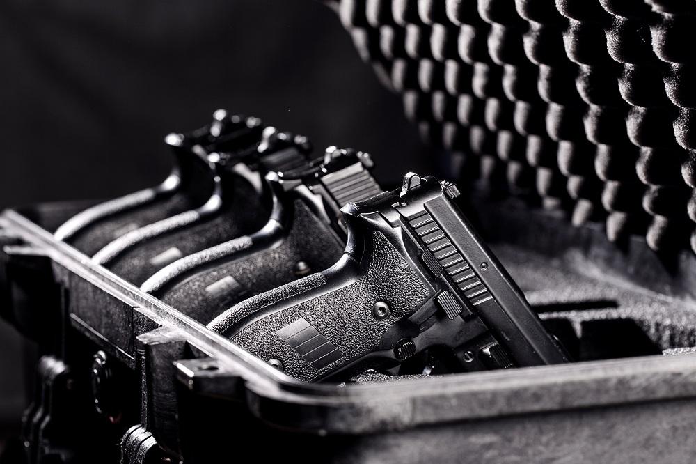 handgun in plastic secure storage Case