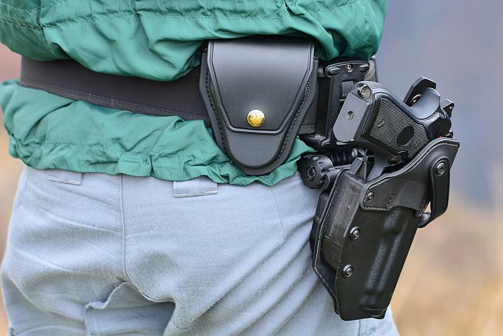 Handgun on a man