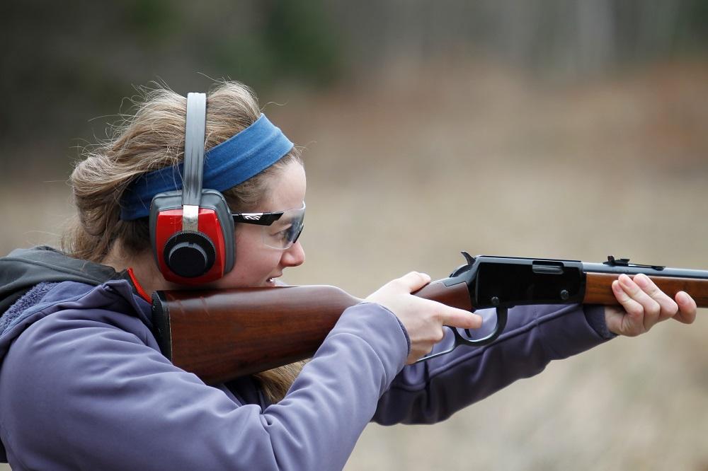 blonde girl firing