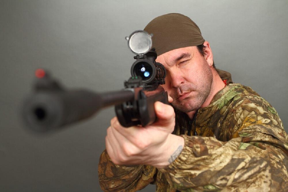 hunter and his rifle