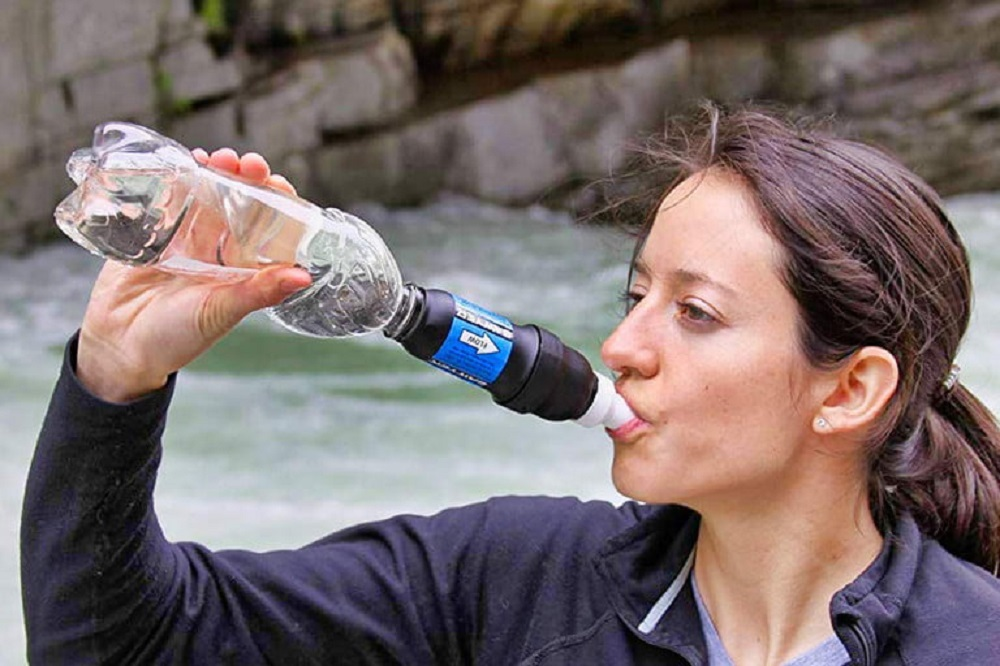 girl drinking filtered water