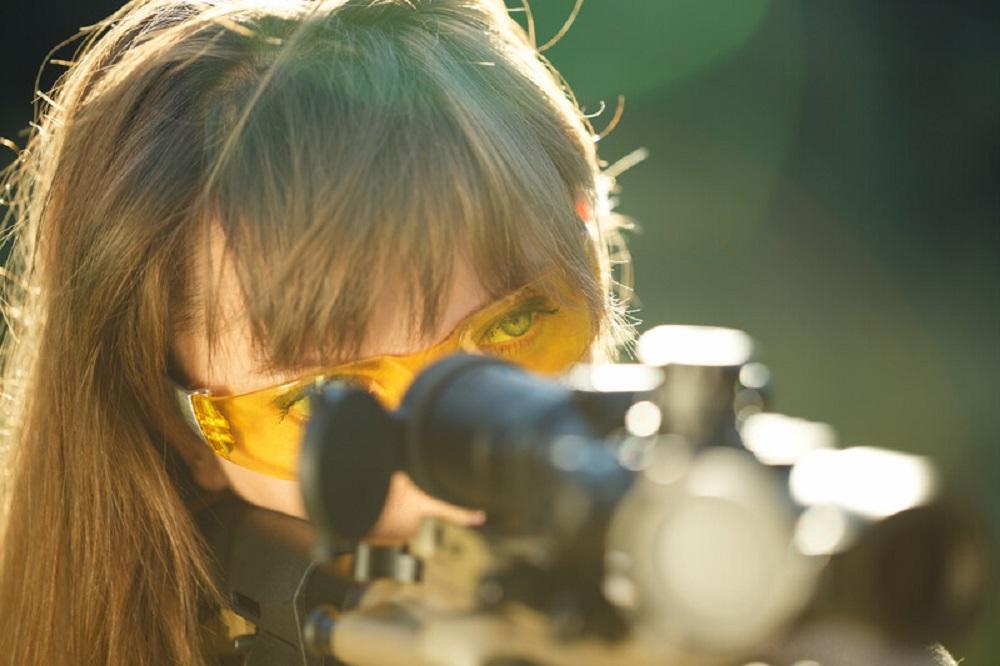 girl aiming at a target