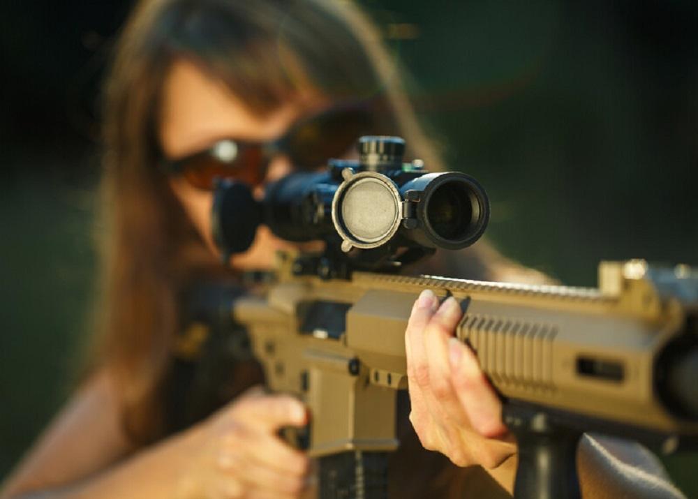girl holding a gun