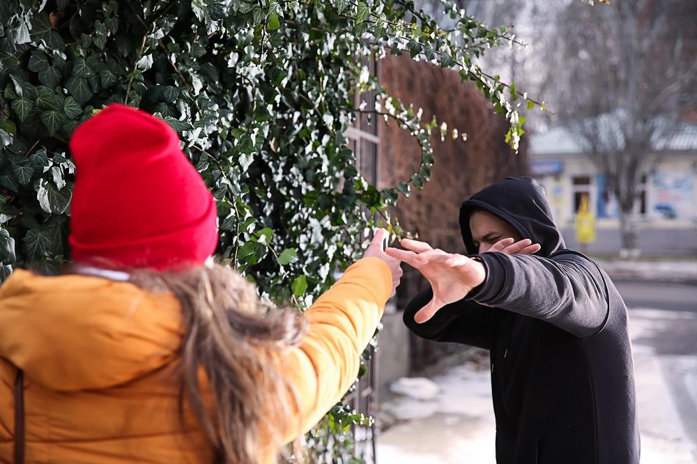 woman using pepper spray