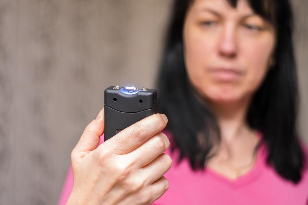 woman holding taser
