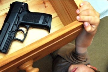 child getting gun from safe