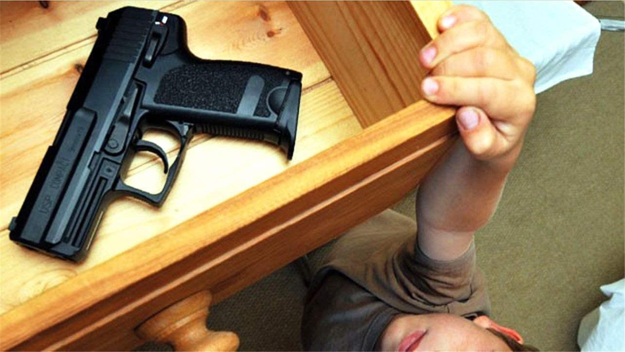child getting gun from safe